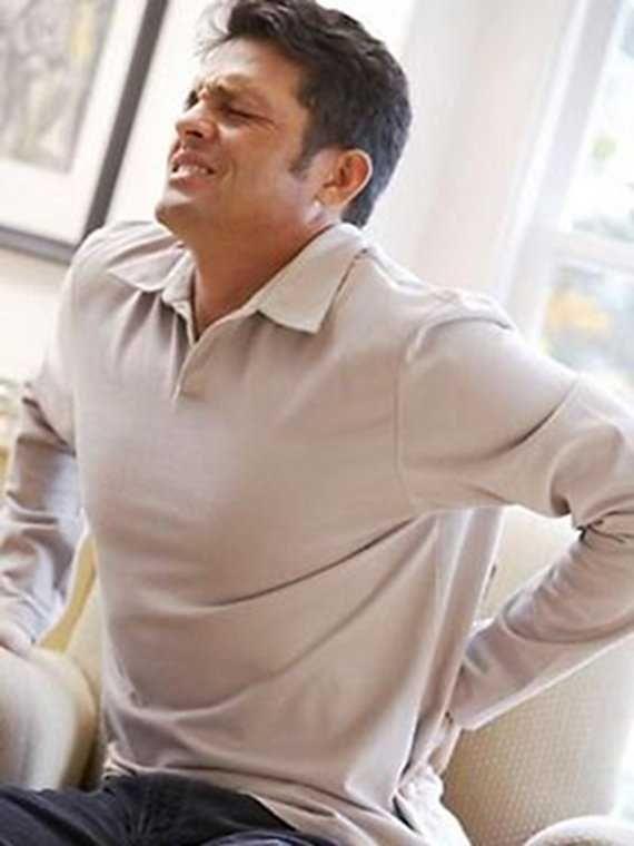Причини болю в спині в області попереку